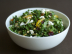 raw kale salad with feta, pine nuts, and cranberries