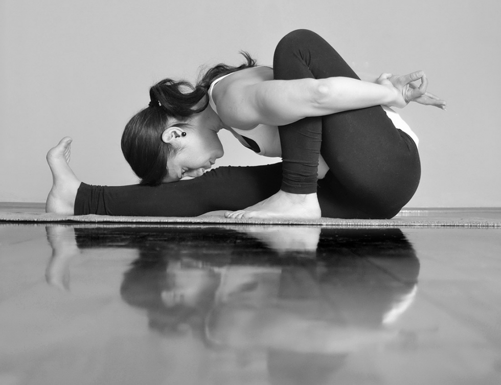 maricyasana-a or spinal twist in sitting